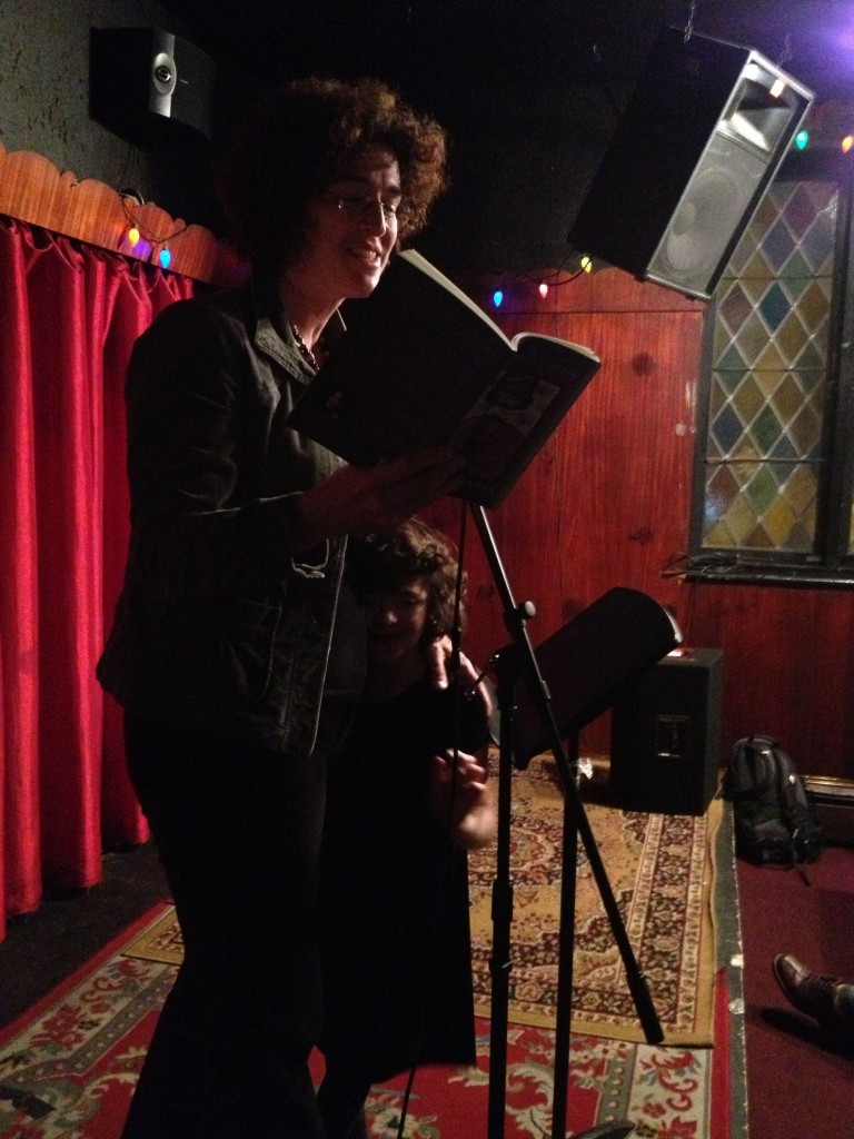 "Daisy Fried with her daughter Maisie, reading from her famous long poem ""Torment."""