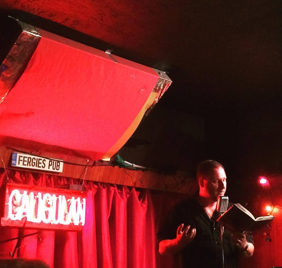 Hilbert reads from Caligulan at the Philadelphia launch at Fergie's Pub, where he performed with Quincy Lehr and the band the Keystone Swingbillies. Photo credit Niamh O'Connell.